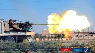 This undated image posted online on  August 24 purports to show an Islamic State fighter in action in the Syrian town of Raqqa.