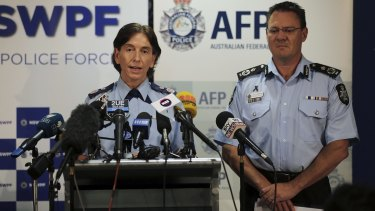 NSW Police Deputy Commissoner Catherine Burn and AFP Deputy Commissoner Michael Phelan during a press conference about two men arrested at Fairfield on Tuesday for alleged terrorism offences.