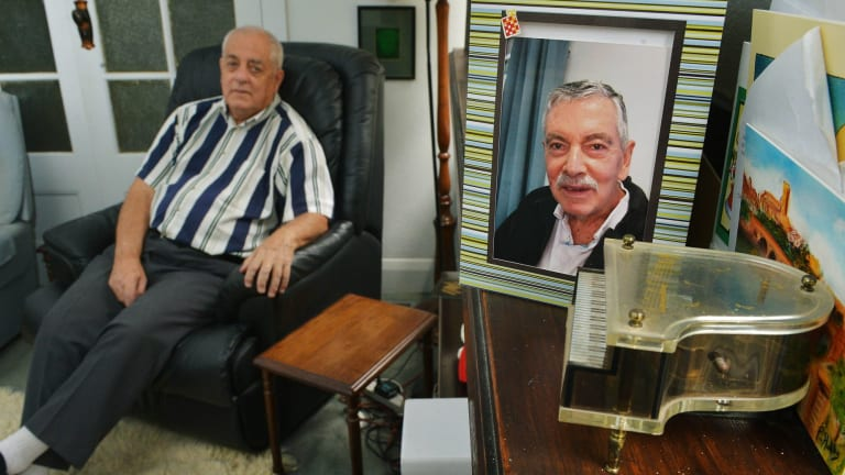 Tony Walsh (left) with a picture of his partner Paul Wenn, who died last year.