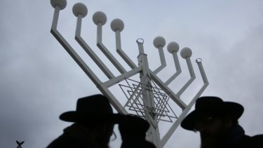 Rabbi Yehuda Teichtal, right, and Rabbi Segal Shmoel, left, inspect a giant Hanukkah Menorah, set up by the Jewish Chabad Educational Centre, at the Pariser Platz in Berlin.