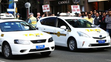 Taxi drivers protested against Uber at NSW State Parliament in September.