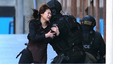 Lindt cafe waitress April Bae runs into the arms of armed tactical response police officers.