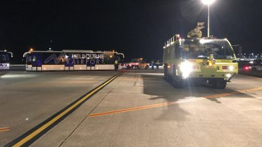 A police vehicle on the tarmac at Melbourne Airport after a man allegedly tried to enter the cockpit of Malaysia Airlines Flight MH128.