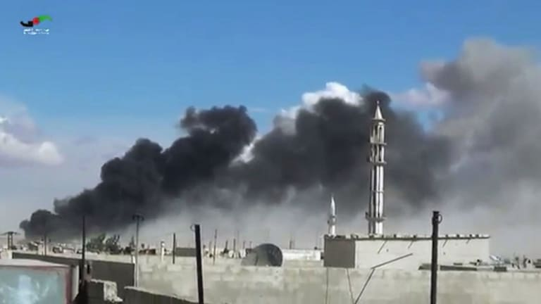 Smoke rises after airstrikes by military jets in Talbiseh, Homs province, western Syria, in 2015.