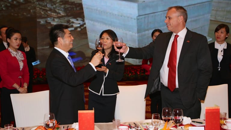 Cheers: Adam Giles, former chief minister of the Northern Territory, toasts Ye Cheng, celebrating the 99-year lease of the Port of Darwin.