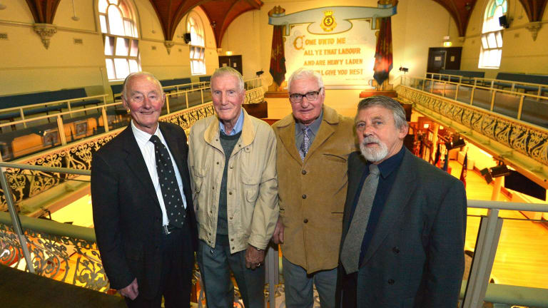 Retired firemen (from left) Laurie Lavelle, Trevor Reed and Les Gray, with journalist Jeff Penberthy, were at the William Booth Memorial Home fire in 1966.