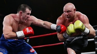 Short and not so sweet: Paul Gallen and Anthony Watts do battle.
