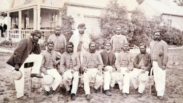 The Aboriginal team on Boxing Day, 1866, outside the MCG. The man at the back wearing a cap is Tom Wills.