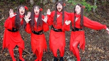 Brisbane park awash with red dresses for Kate Bush tribute