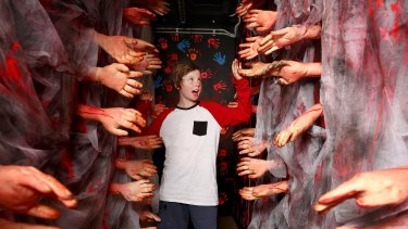 Halloween celebrations: Jason Brivik comes to grips with the Circus of Screams at Luna Park.