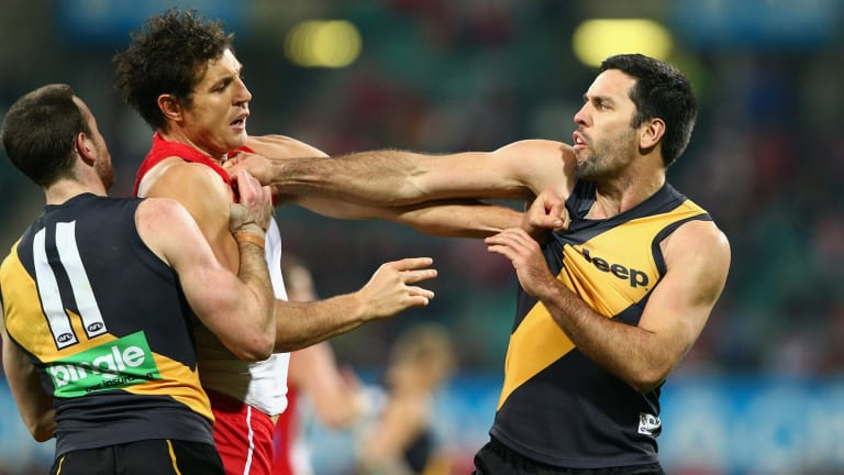 Troy Chaplin and Kurt Tippett go toe to toe.