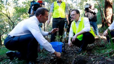 The Green Army was a signature environment policy when Tony Abbott (left) was prime minister, and Greg Hunt (right) his environment minister.