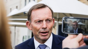Former Australian prime minister Tony Abbott addresses the media in Hobart.