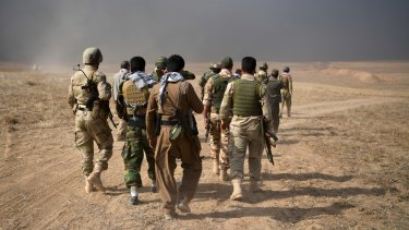 Kurdish soldiers during an attack to recapture the village of Tiskharab, near Mosul.