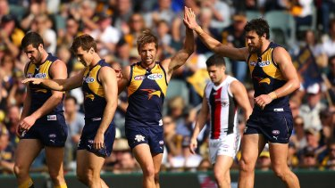 Best in the west: Eagles Mark LeCras and Josh Kennedy celebrate a goal against St Kilda.