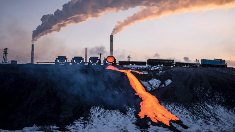 Molten ore is poured into a storage area at a copper factory in Norilsk.