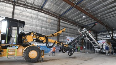 The first excavating equipment for the WestConnex tunnels makes its way down a ramp at Concord on Monday.
