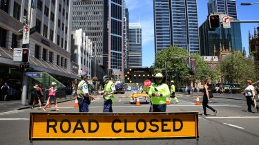 Construction workers organise the implementation of the light rail system in the CBD.