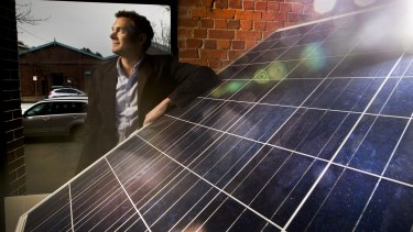Sun Edison Australia managing director Jeremy Rich with a solar panel which his company will install for free. The company  then sells the power back to the household at a rate that, on average, is about 50 per cent cheaper than the grid.