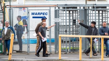 Former Ford workers leaving the Broadmeadows plant at the end of their last shift