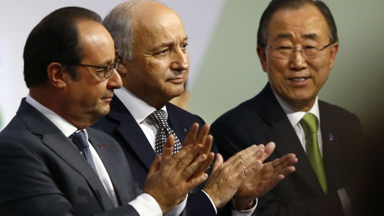 French President Francois Hollande, left, French Foreign Minister Laurent Fabius and UN Secretary-General Ban Ki-moon at the Paris climate conference on Saturday.