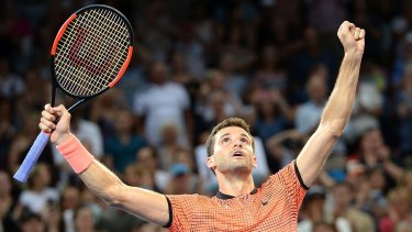 Run of form: Grigor Dimitrov celebrates victory against Kei Nishikori.