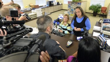 Rowan County Clerk Kim Davis, right, talks with David Moore following her office's refusal to issue marriage licences at the Rowan County Courthouse in Morehead, Kentucky, on Tuesday.