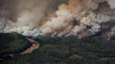Smoke rises from Canadian wildfires burning near Fort McMurray, Alberta as the fire season started a month early this year.