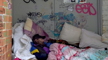 A man sleeping in Turner Alley on Tuesday morning.