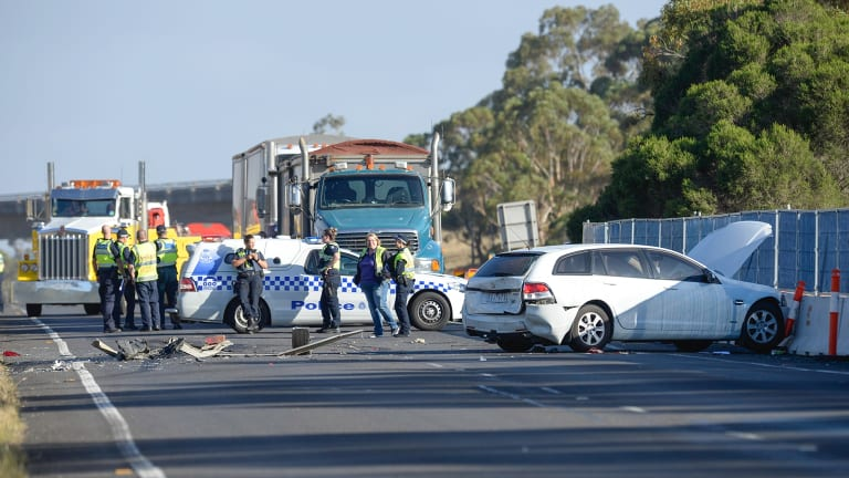 The Calder Freeway on Friday morning, after a truck ran over a car.