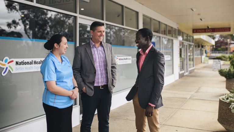 Nurse Kieth Ancheta, left, director Adrian Watts and medical director Joe Oguns outside the National Health Co-op medical clinic in Macquarie.