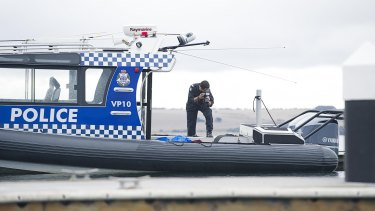 Police at the scene of the crash of a plane which killed four people.