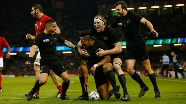 Total domination:  New Zealand players celebrate with try scorer Julian Savea.