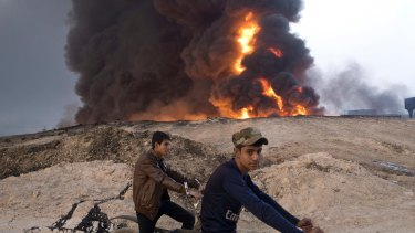 IS militants torched oil wells around Mosul as the fight continues.