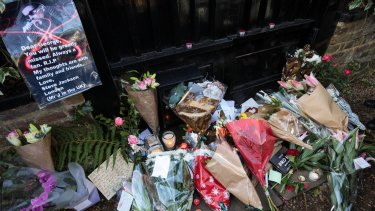 Fans left flowers and cards outside his home.