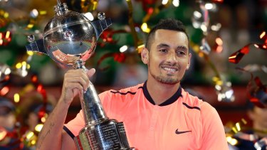 Nick Kyrgios with his third tour trophy of the year in Japan.