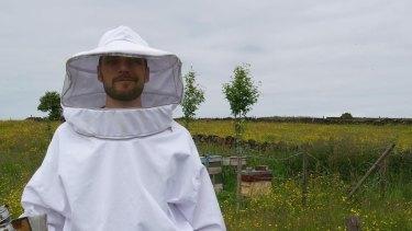 Australian National University biologist Dr Luke Holman in the field, literally, researching bees.