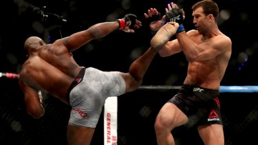Pyrrhic victory: Yoel Romero from Cuba launches a kick at Luke Rockhold.