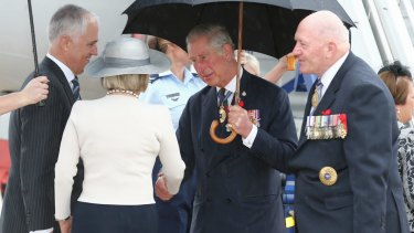 Prince Charles is greeted by Prime Minister Malcolm Turnbull, Lucy Turnbull and Governor-General Sir Peter Cosgrove on his arrival in Canberra on Wednesday.