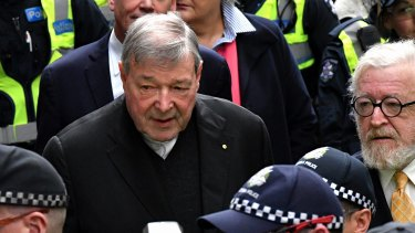 George Pell leaves the Melbourne Magistrates Court in October.