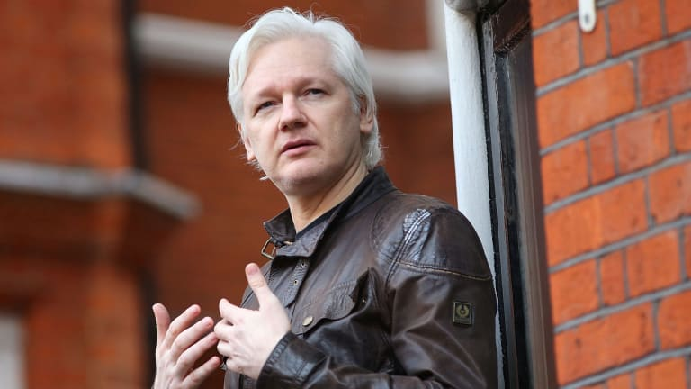Julian Assange speaks to the media from the balcony of the Embassy Of Ecuador in London.