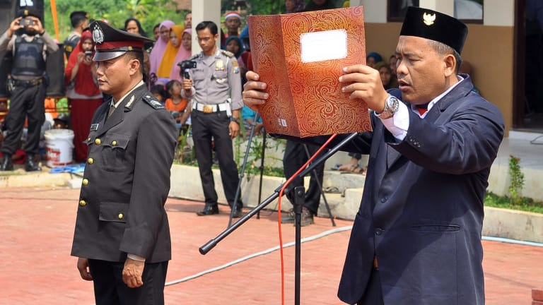Ali Fauzi, brother of the Bali bombers and Chairman of the Lingkar Perdamaian Foundation reads the proclamation of independence of Indonesia in Tenggulun on Thursday.