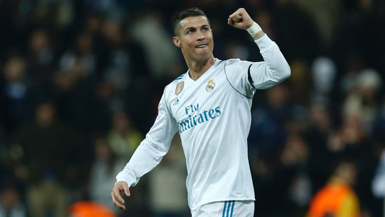High five: Real Madrid forward Cristiano Ronaldo edged out Messi for this year's top spot and his fifth Ballon d'Or.