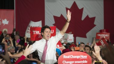 Liberal Leader Justin Trudeau waves to supporters as he takes the stage at a campaign rally in Winnipeg, Manitoba, Canada on Saturday.