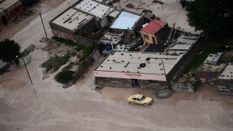 Road are covered in mud after a landslide triggered by a storm in the village of Volcan, Argentina.