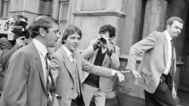 Christopher Dale Flannery being led handcuffed into the City Watch-house to be charged with murder in October, 1981.