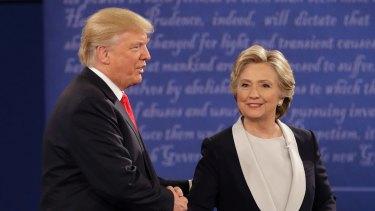 Donald Trump and Hillary Clinton shake hands.