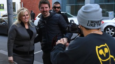 A fan grabs a photo with Rebel Wilson outside court on Monday