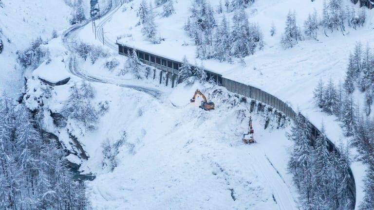 A digger at work where an avalanche has blocked the road between Taesch and Zermatt.