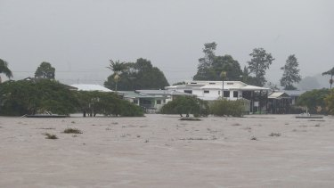 Semi-submerged homes along the Tweed River at Murwillumbah.
